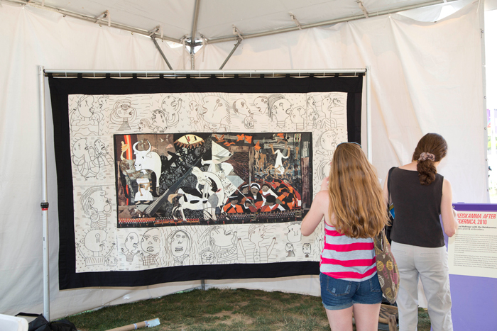 Festival visitors contemplate Keiskamma After Guernica at the 2012 Smithsonian Folklife Festival.