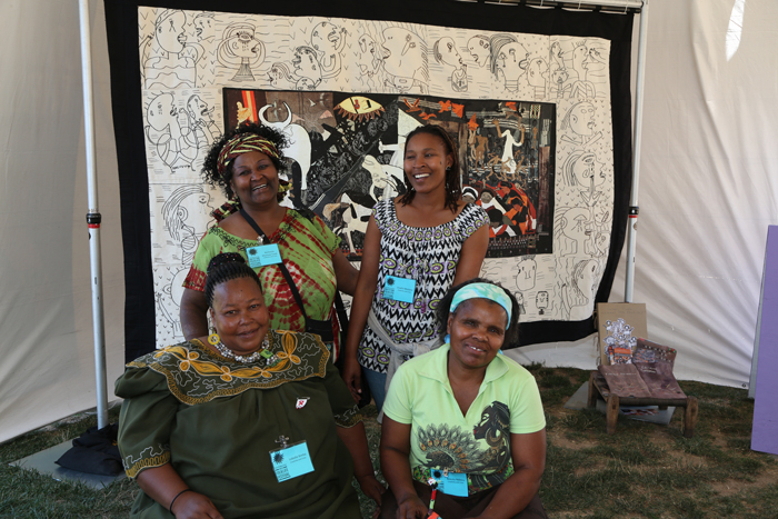 "Festival participants Nomvula Mashoai-Cook, Beauty Ndlovu, Lobolile Ximba, and Unathi Meslane in the ""Common Threads"" tent at the 2012 Smithsonian Folklife Festival."