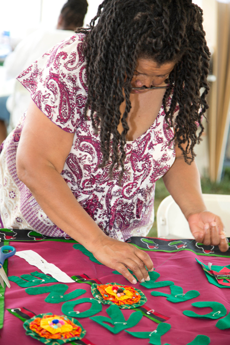 A Festival visitor works on a panel at the 2012 Smithsonian Folklife Festival.