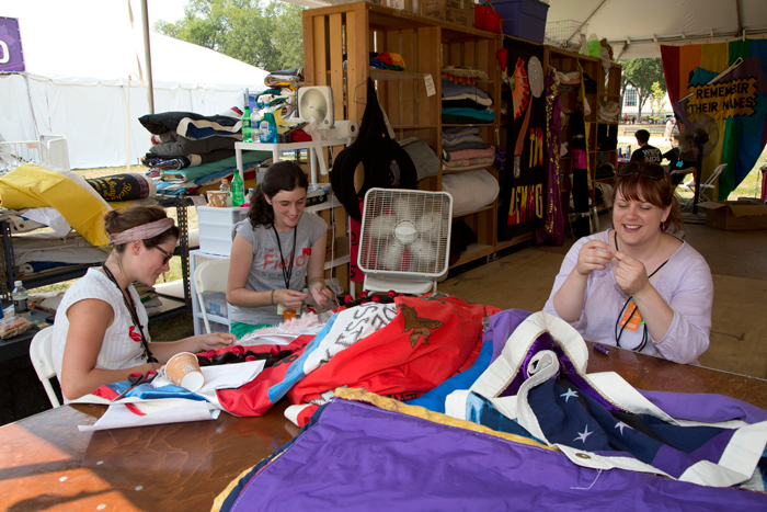 Volunteers care for a panel of The AIDS Memorial Quilt at the 2012 Smithsonian Folklife Festival.