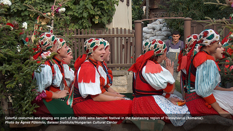 Colorful costumes and singing are part of the 2005 wine harvest festival in the Kalotaszeg region of Transylvania (Romania). Photo by Ágnes Fülemile, Balassi Institute/Hungarian Cultural Center