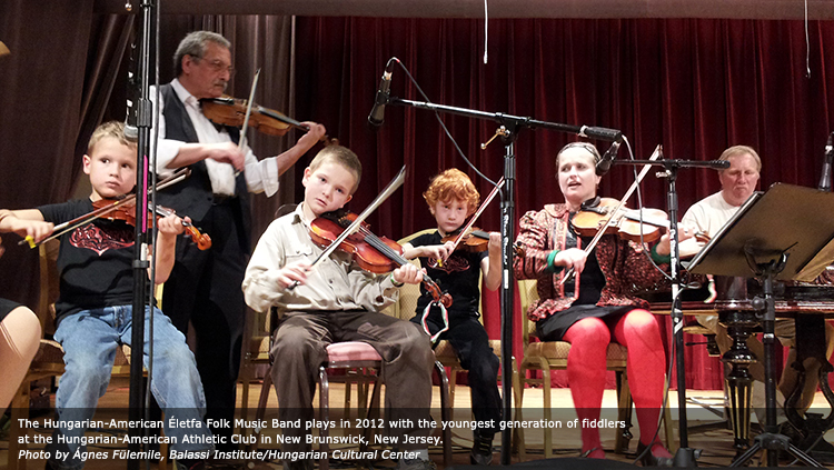 The Hungarian-American Életfa Folk Music Band plays in 2012 with the youngest generation of fiddlers at the Hungarian-American Athletic Club in New Brunswick, New Jersey. Photo by Ágnes Fülemile, Balassi Institute/Hungarian Cultural Center