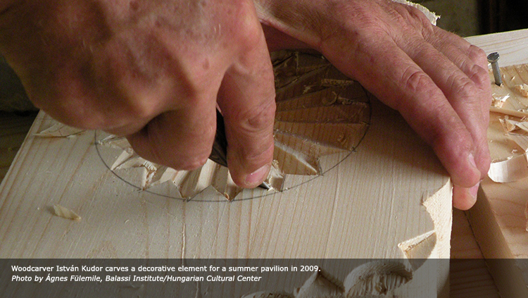 Woodcarver István Kudor carves a decorative element for a summer pavilion in 2009. Photo by Ágnes Fülemile, Balassi Institute/Hungarian Cultural Center