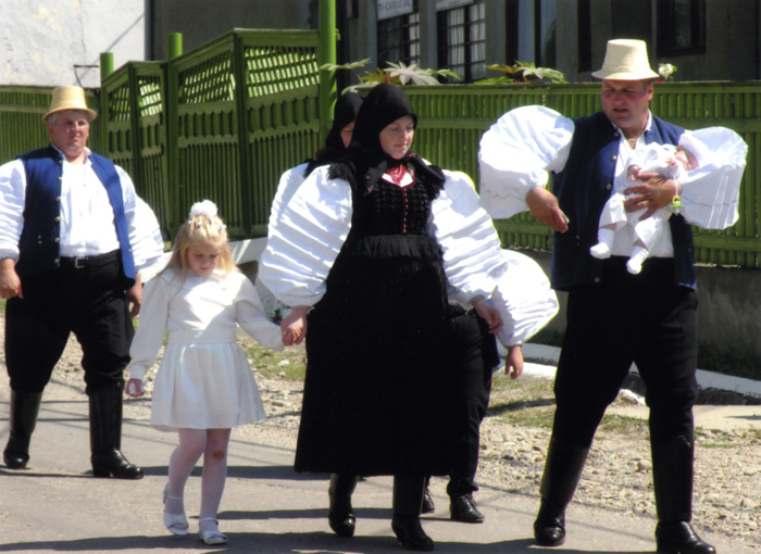 Parents and godparents in Szék, Transylvania (Romania), walk to the church for the baptism of their youngest child in 2005.