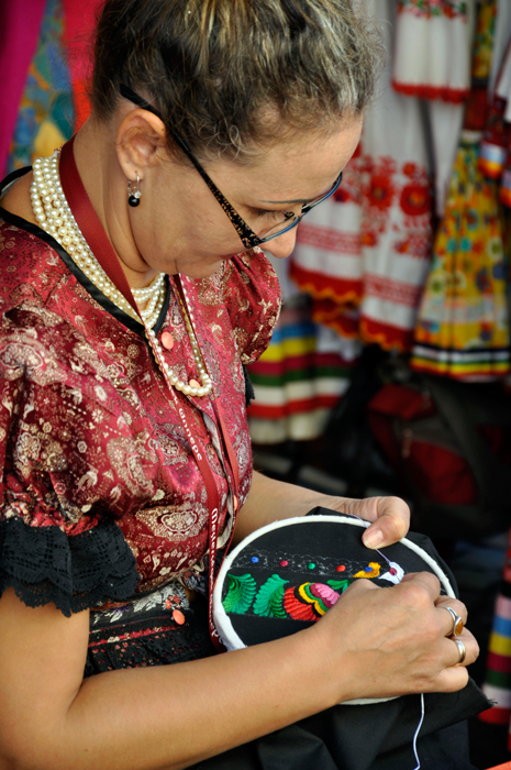 Bernadett Papp from Mezõkövesd in northern Hungary displays her embroidery skills at a festival in 2011. Mez&otildekövesd is celebrated for its contemporary folk art, especially folk costume and embroidery.