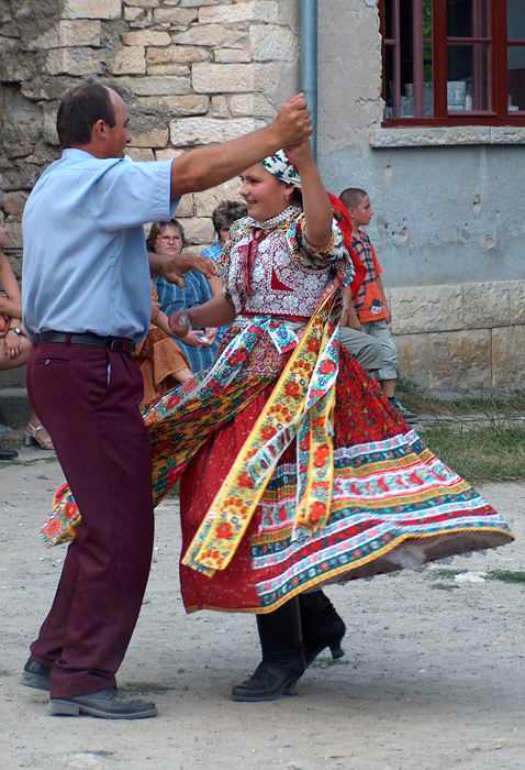 A father and his daughter dance at a wine harvest festival in the Kalotaszeg region of Transylvania (Romania), 2010.