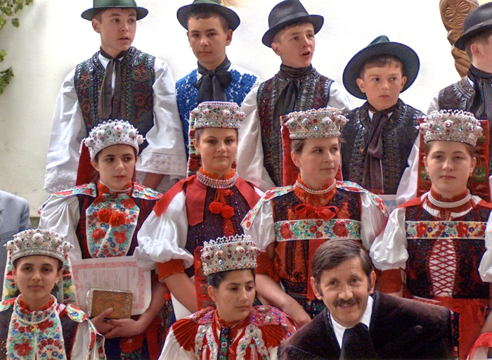 Young adults dress in traditional folk costumes for their first communion in the Kalotaszeg region of Transylvania (Romania) in 2006. In this most emblematic region of Hungarian folk art, churches encourage the preservation of folk costume for special events and holidays.