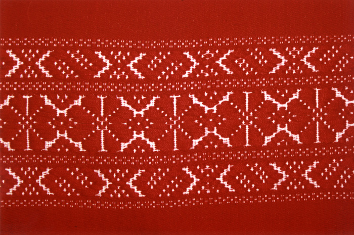 Homespun textiles from Kalotaszeg, Transylvania (Romania), frequently feature geometric designs on red cloth.