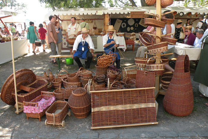 Wicker baskets surround the craftsmen at the Festival of Folk Arts in Budapest, 2012.