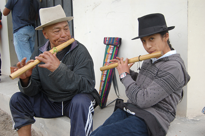 Flute master Mariano Maldonado (left) practices a song with one of his students, Michael Chiza, after a Sunday class at the Hatun Kotama Flute School in Kotama, Ecuador.