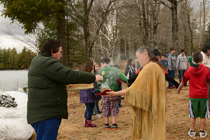 Passamaquoddy elder, culture expert, and language educator Wayne Newell and spiritual elder Joan Dana participate in a traditional Ice Out ceremony on the Passamaquoddy Reservation in Indian Township, Maine. Wayne Newell is a native Passamaquoddy speaker who has worked tirelessly to preserve and pass on the language and cultural traditions of his tribe for future generations.