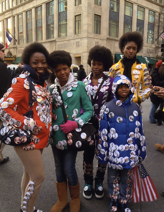 Young people at the 2013 inauguration of President Obama creatively adorn themselves with campaign buttons.