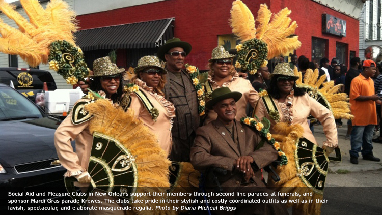 Social Aid and Pleasure Clubs in New Orleans support their members through second line parades at funerals, and sponsor Mardi Gras parade Krewes. The clubs take pride in their stylish and costly coordinated outfits as well as in their lavish, spectacular, and elaborate masquerade regalia. Photo by Diana Micheal Briggs