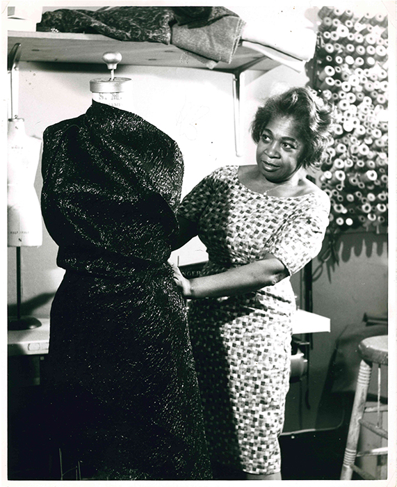 Designer Zelda Wynn Valdes demonstrates the art of draping on a dress form.