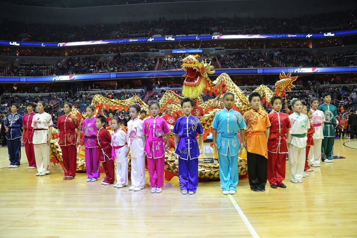 The U.S. Wushu Academy dragon dance team performs during the half-time show for a Washington Wizards game at the Verizon Center, Washington, D.C., 2014.