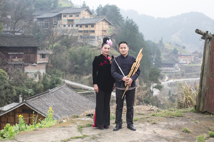 (L to R) Li Lingting and Mo Ming, a <i>lusheng</i> player and maker, pose in their village in Leishan County, Guizhou Province, 2014.