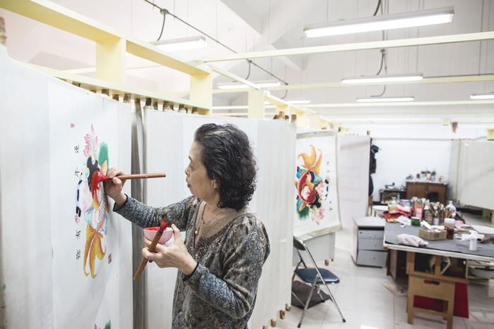 Chen Yuhua specializes in hand-painting additional color to the New Year's prints after they have been printed.