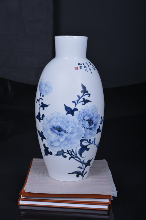 A painted porcelain vase by Sun Lixin.