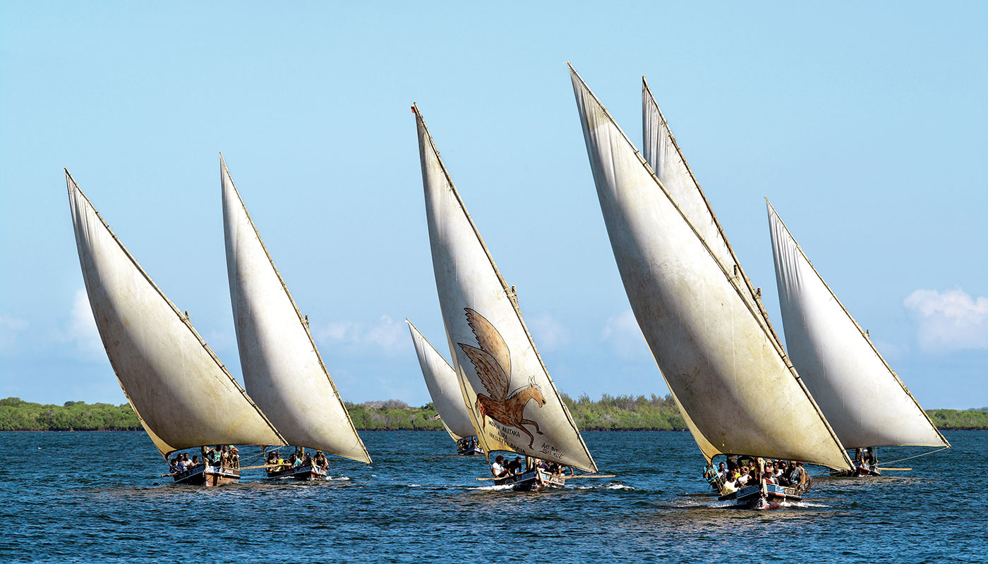 While jumbo jets, crowded superhighways, and the Internet now move people and ideas around Kenya at an unprecedented pace, the graceful dhow remains a key vehicle for livelihood and exchange between Kenya's coastal communities and neighbors around the Indian Ocean. Dhow races also are a popular competitive sport along the Kenyan coast. Photo by David Coulson