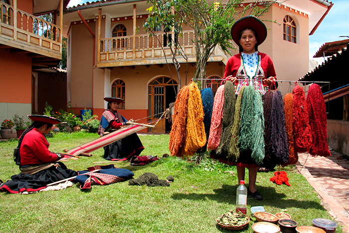 Weavers use natural dyes to create brilliant colors for their textiles.