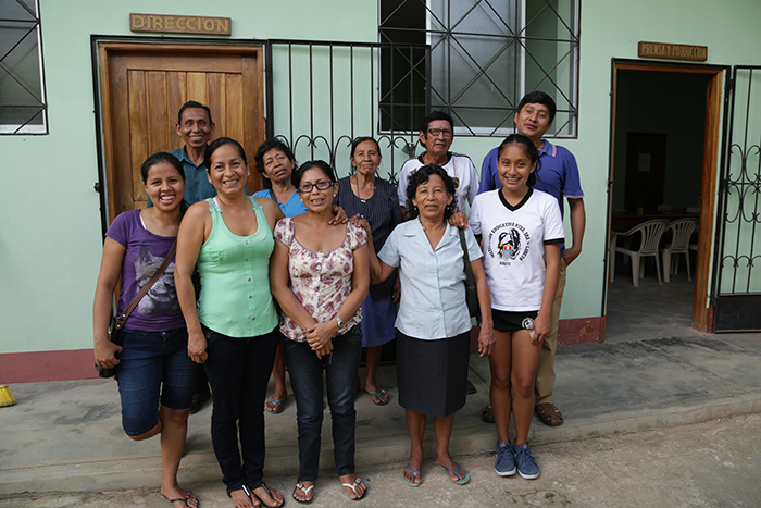 Teachers and producers from Radio Ucamara take a group photo outside the station in Nauta. They research and broadcast community engagement projects, including an initiative to revitalize their native language of Kukama.
