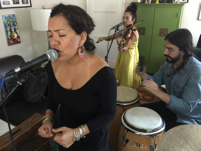 Martha González, Tylana Enomoto, and Alberto López, of Quetzal rehearse in González's living room in Los Angeles, 2015.