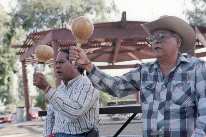 Stan Rodriguez (left) and his teacher, master Kumeyaay singer Jon Meza Cuero, practice in a San Diego park, 2001.