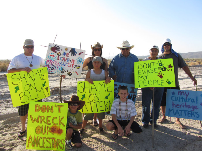 Preston J. Arrow-weed (in blue denim shirt) and Helena Quintana Arrow-weed (on the right) participate in a protest in Ocotillo, California, against a construction project that threatened Quechan cultural sites.