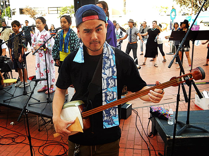 Sean Miura, who is fourth generation Japanese American, started learning the <em>shamisen</em> when he was a teenager.
