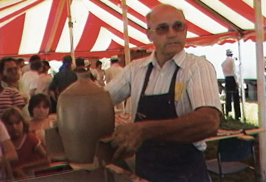 Cleater Meaders Jr. working in the Festival tent.