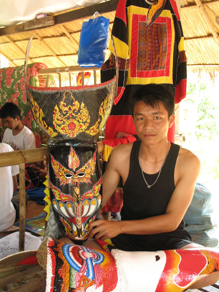 Wirayut Natsaengsri with two of his masks in Dansai village, Thailand, in 2006. Photo by Sunee Prasongbandit, Ralph Rinzler Folklife Archives