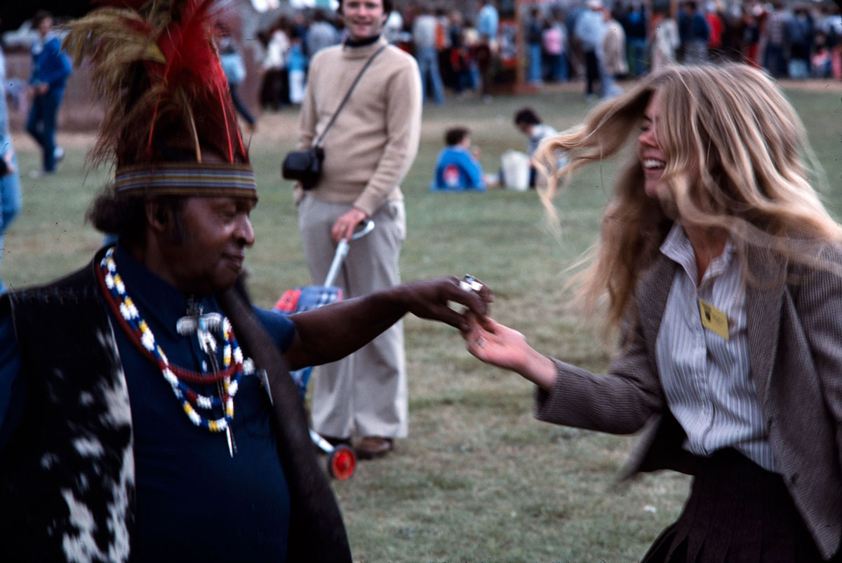 Folklife curator Marjorie Hunt dances with a participant at the 1978 Festival.