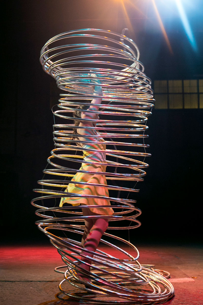 Using her entire body, this performer rotates more than thirty hoops simultaneously.
