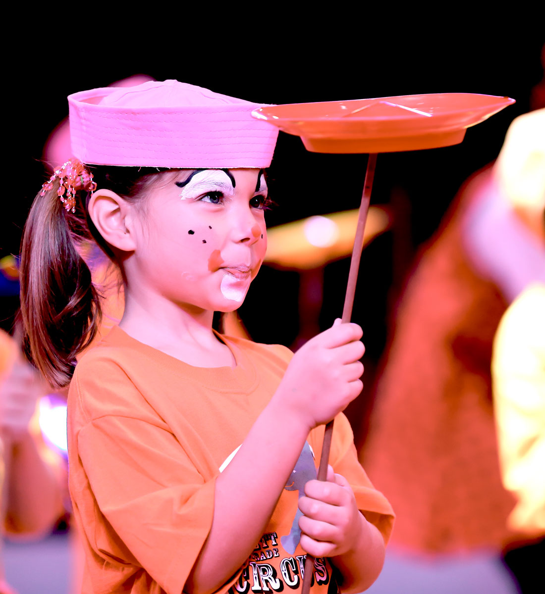A first-grade student spins a plate in the Circus Sarasota Big Top with the Build-a-Circus program.