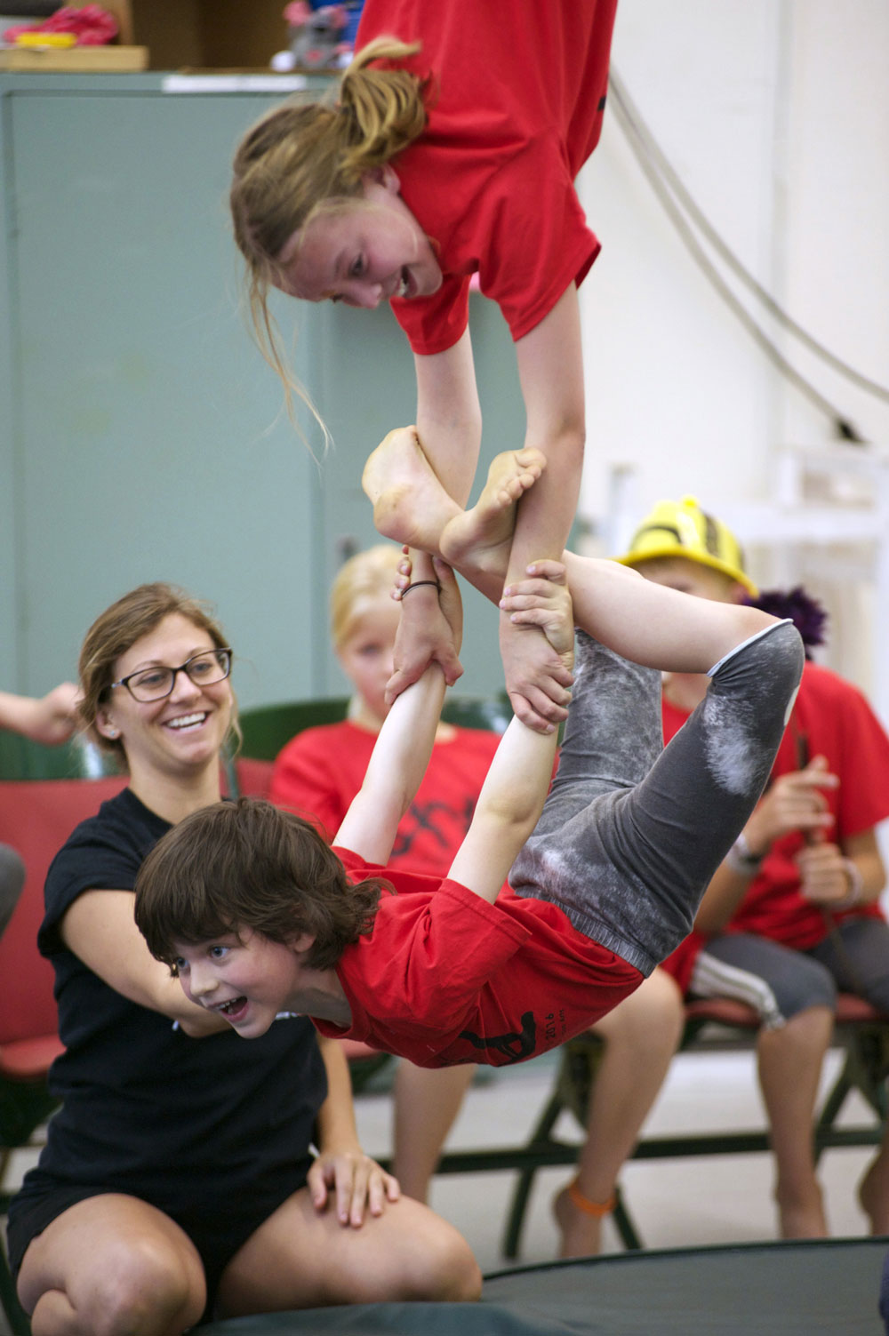Young campers learn a duo trapeze act.