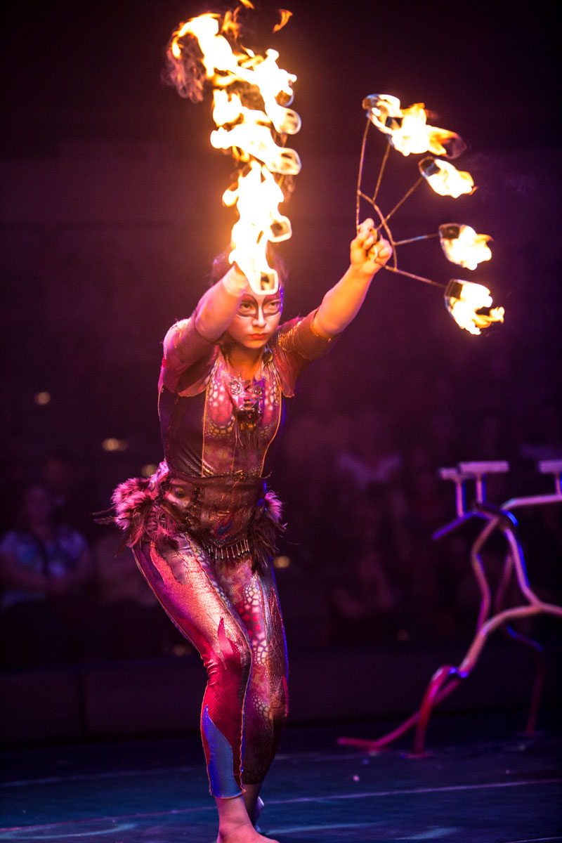 A Circus Juventas performer demonstrates the fire fans.