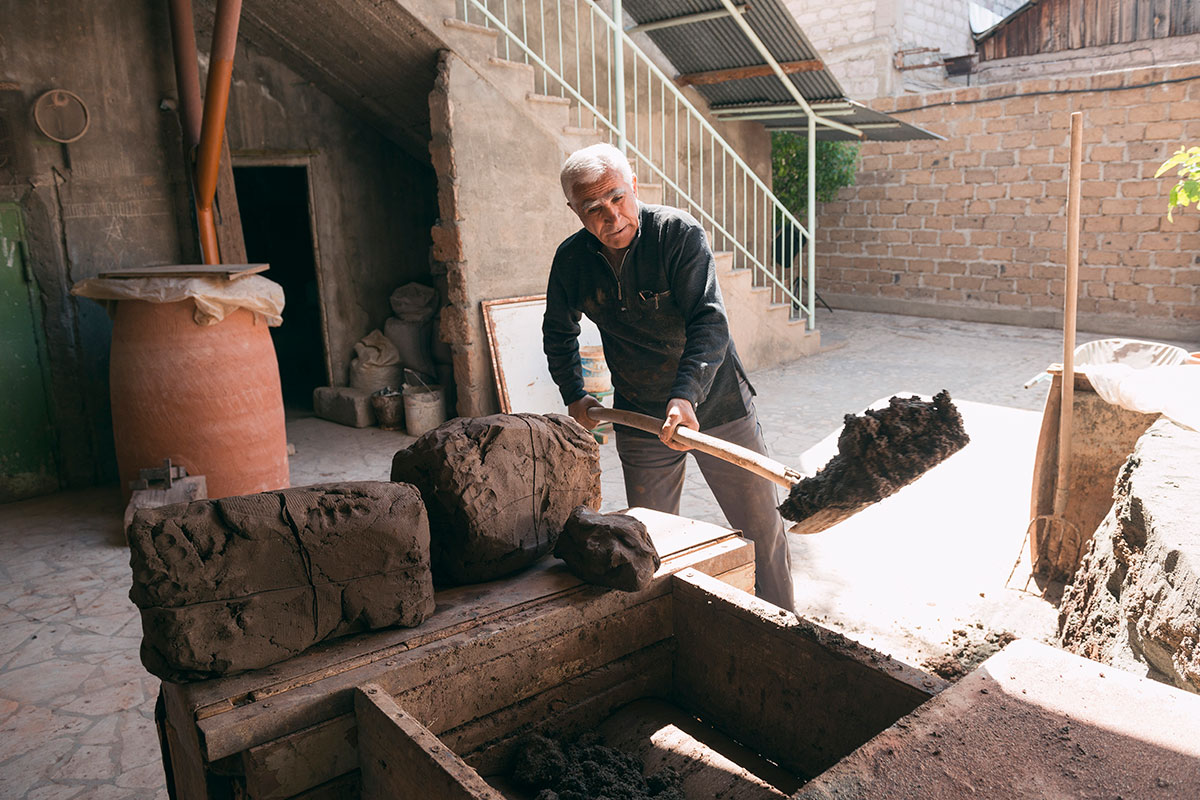Gegham Gharibyan prepares clay for making a tonir.