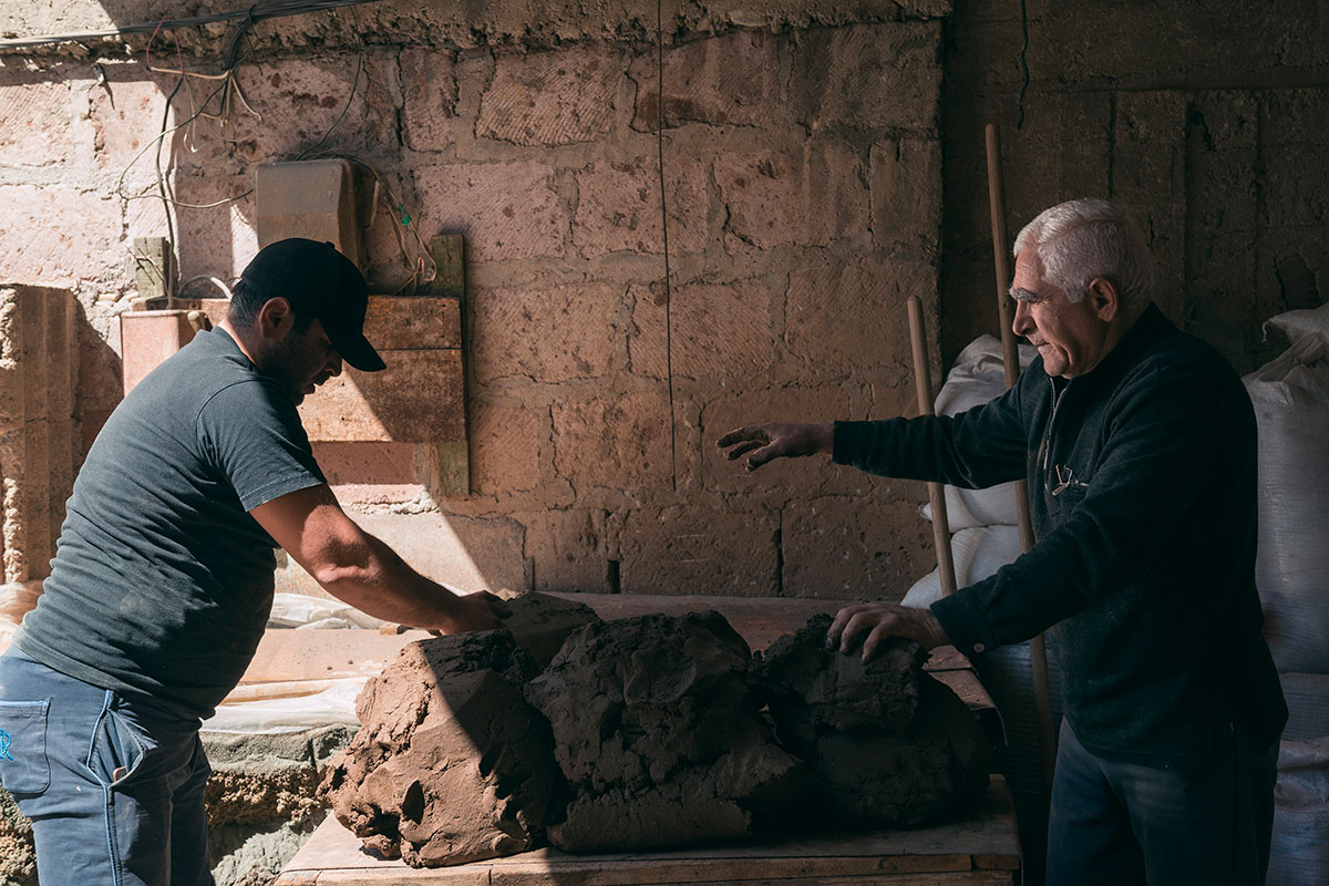 The tradition of making tonir has passed through generations of the Gharibyan family. Here Gegham and his son prepare the clay.
