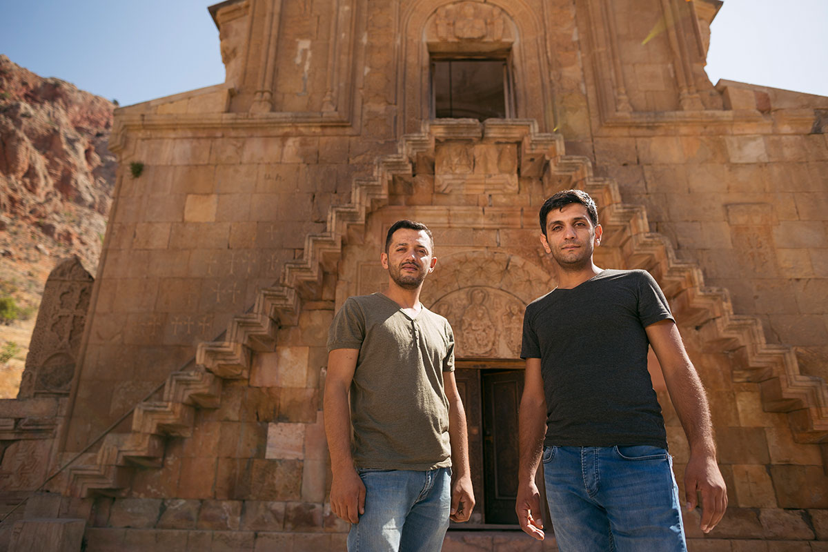 Brothers Ruben and Karen Ghazaryan stand outside Noravank monastery, where they draw inspiration for their carvings.