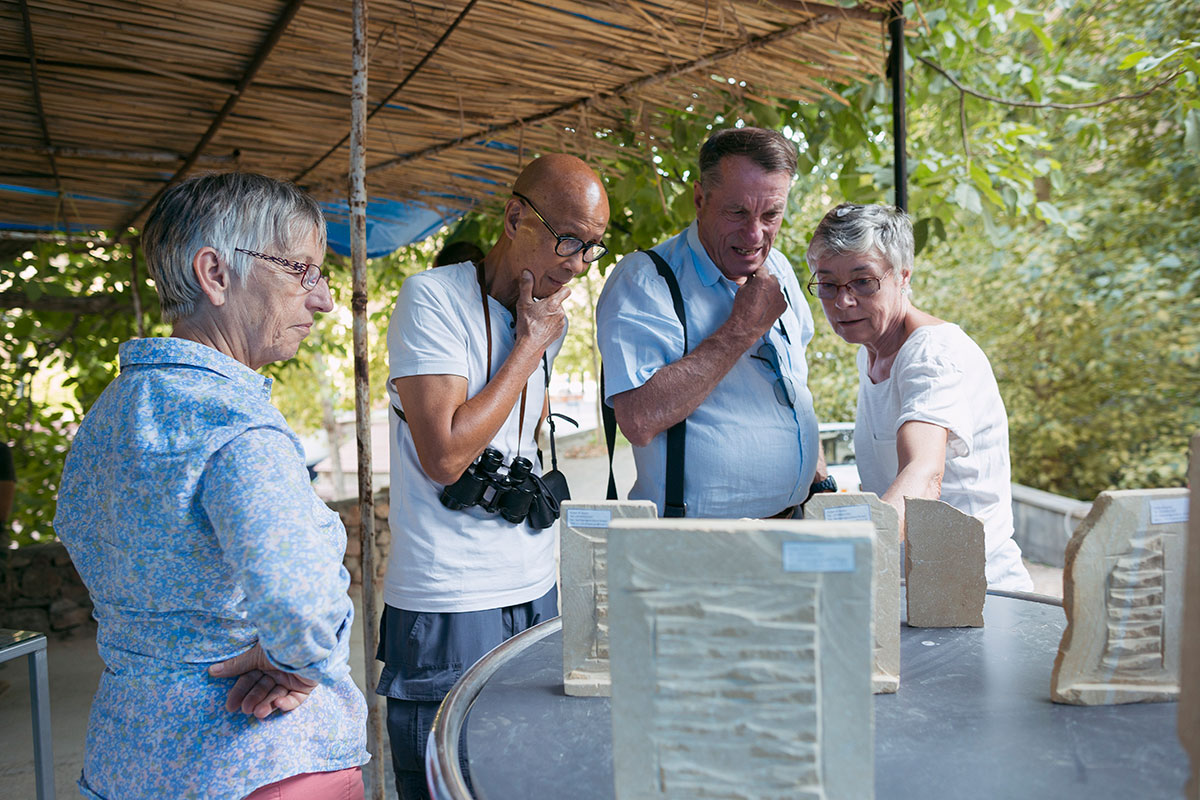 Tourists look at the Ghazaryans' finished khachkar pieces, made smaller for ease of travel.