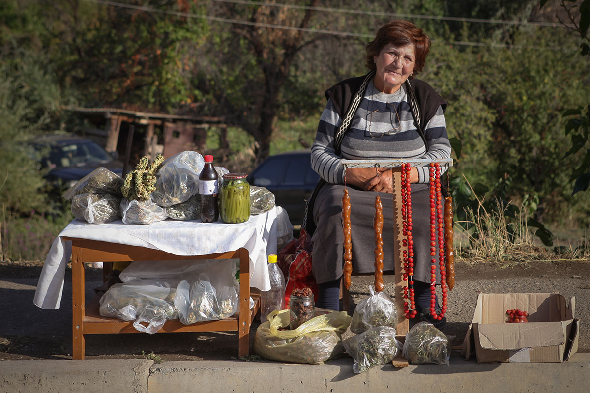 Farmers and villagers alike set up stalls along the road to sell their wares. This woman is selling bags of dried aveluk (wild sorrel) and sujukh, a sweet made from walnuts dipped into grape or mulberry syrup.