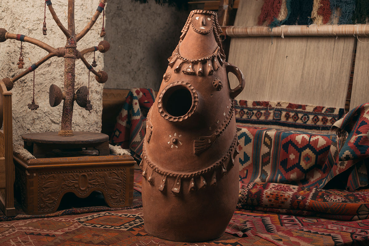 A traditional clay salt jar in the shape of a pregnant woman at the Hovhannes Sharambeyan Folk Arts and Crafts Center in Yerevan.