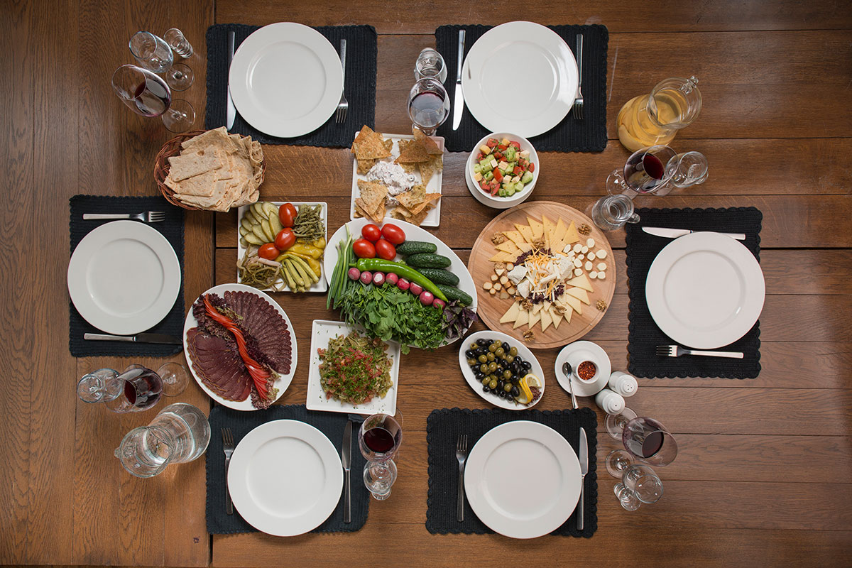 On a table properly set for a feast, food should fill every available space.