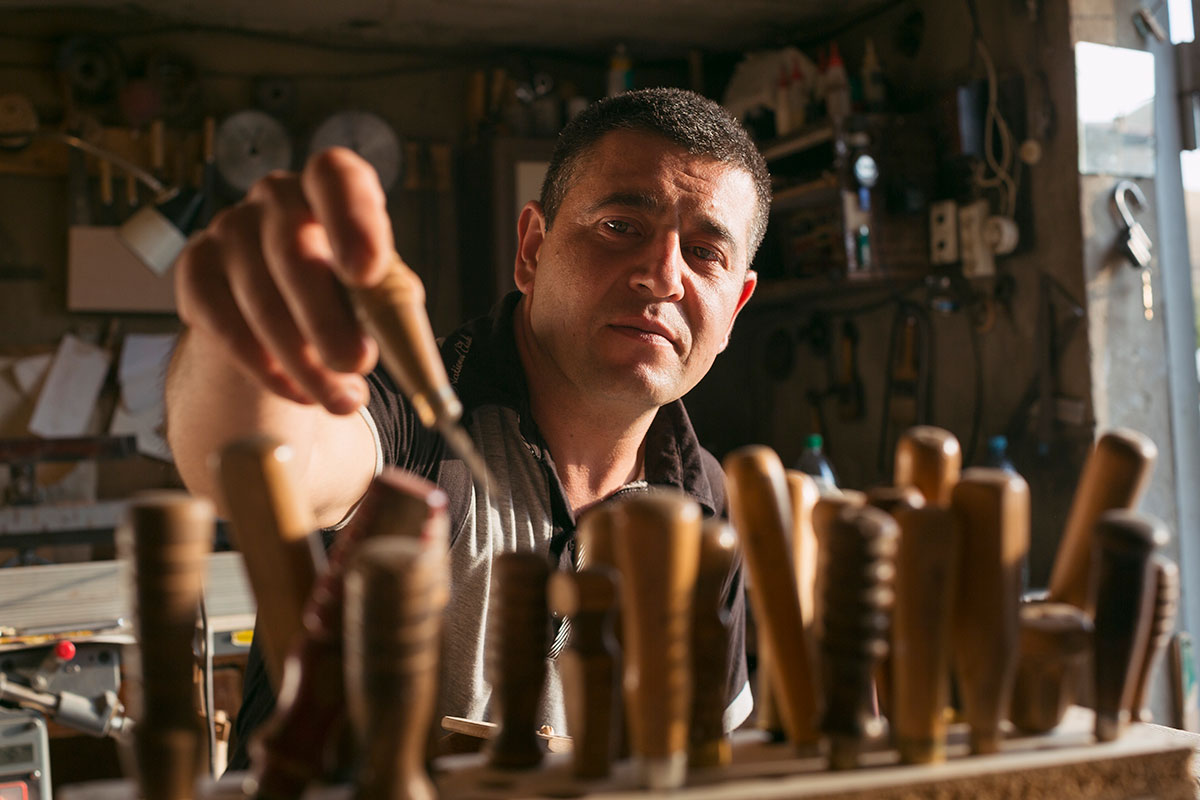 Woodcarver Armen Ohanyan chooses from among his handmade carving tools in his workshop in Sisian.