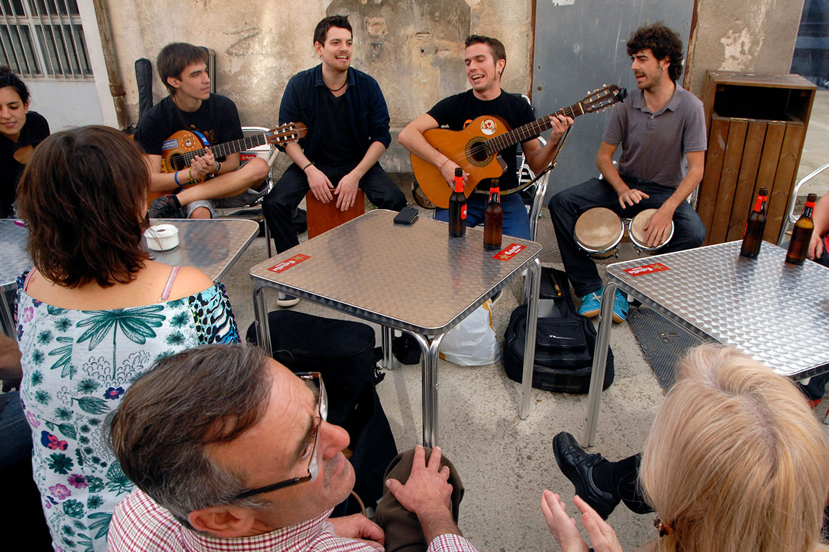 Musicians perform Catalan rumba, a music genre that developed in Barcelona's Romani community in the 1950s.