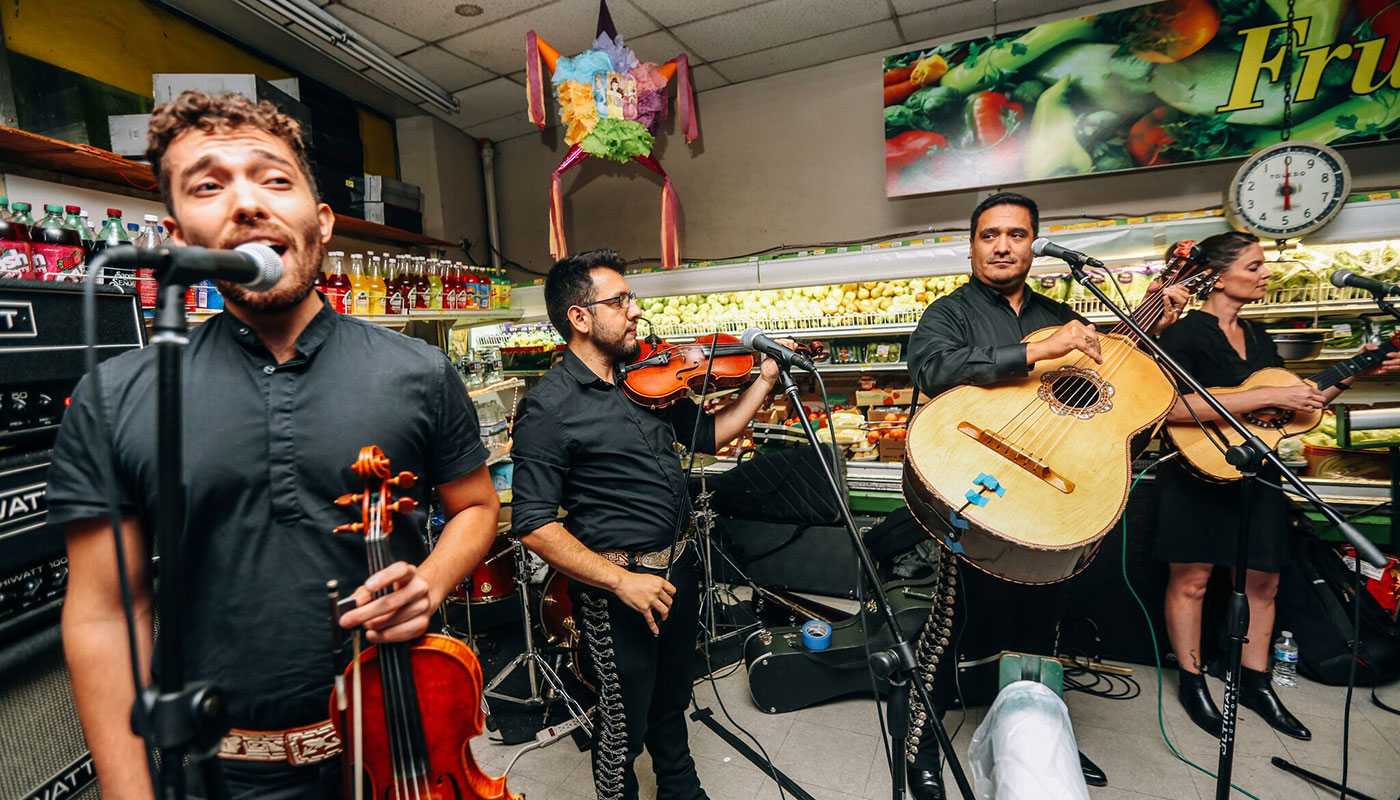 Los Gallos Negros perform at a benefit for the Bestway grocery store in Mt. Pleasant, Washington, D.C., 2018