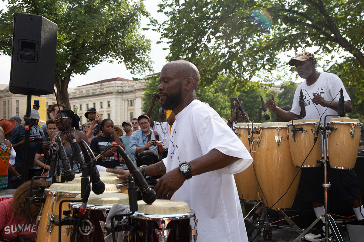 Two men surrounded the crowd and played Konga drums outside.