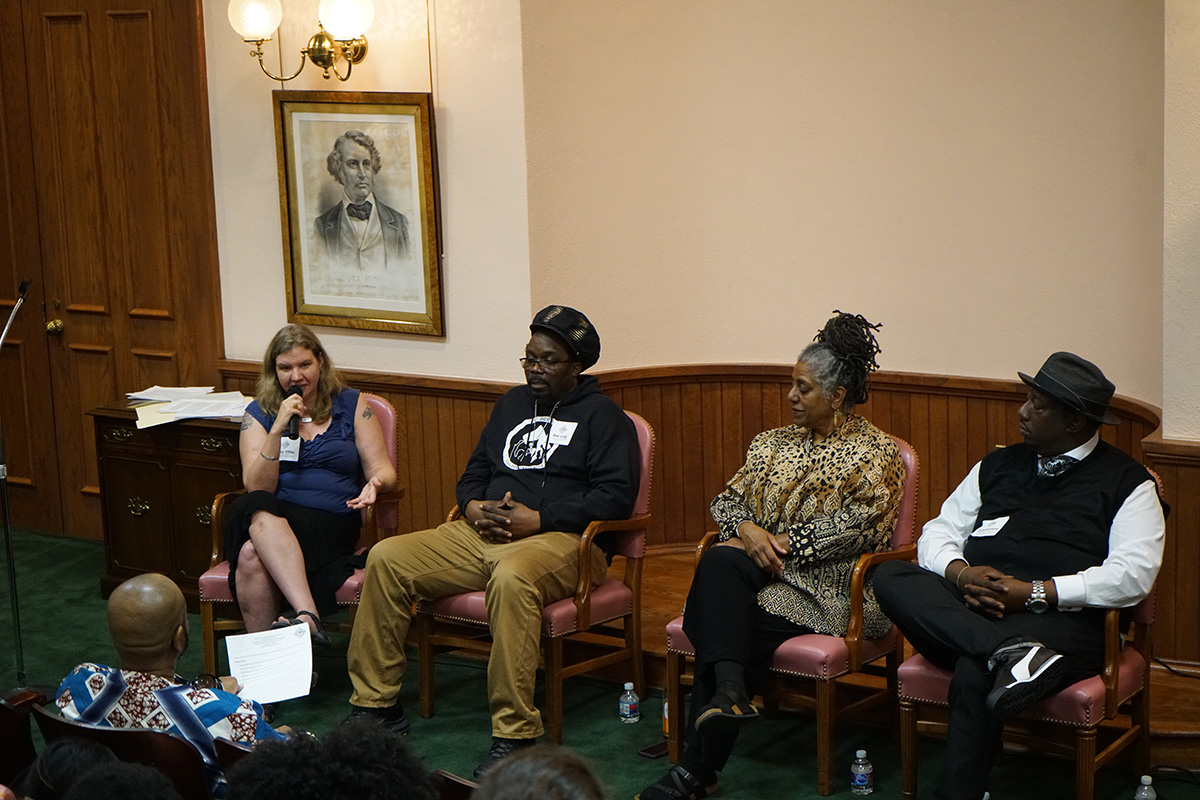 Katy Otto, Infinite, Elise Bryant, and Ras Lidj take part in a discussion panel moderated by Vance Levy