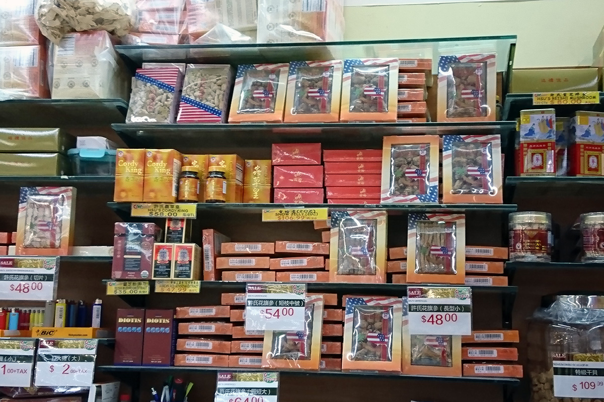 Shelves full of boxes of ginseng products at an Asian grocery store