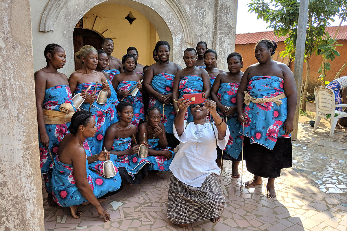 Festival director Sabrina Lynn Motley poses with women of the historic royal family of Hogbonou, Porto-Novo, Benin.
